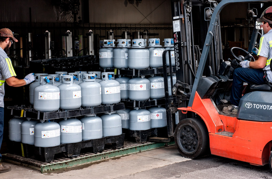 Forklift moving pallet of propane cylidners